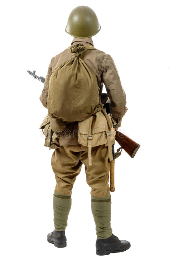 young Soviet soldier with rifle, back view, on the white background stock photo