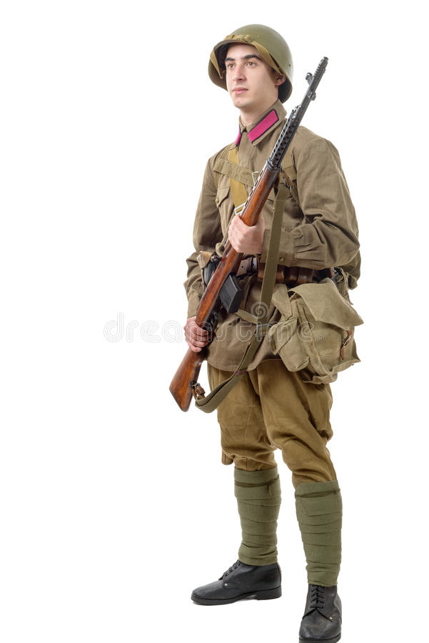 Young Soviet soldier with rifle on the white background royalty free stock photography