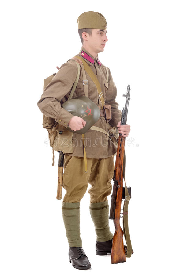 Young Soviet soldier with rifle on the white background royalty free stock image