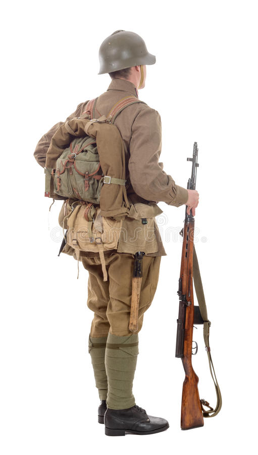 Young Soviet soldier with rifle on the white background royalty free stock photos