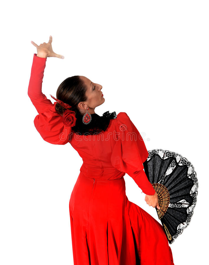 Young spanish woman dancing flamenco in typical folk red dress. Young spanish woman dancing Sevillanas with black fan wearing typical folk red dress in flamenco royalty free stock photos