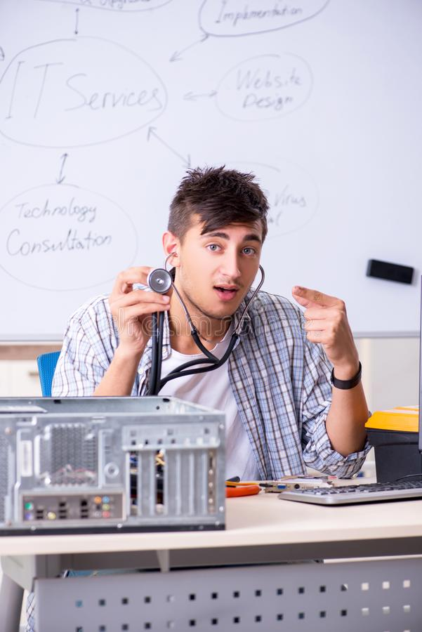 The young it specialist in front of the whiteboard royalty free stock image