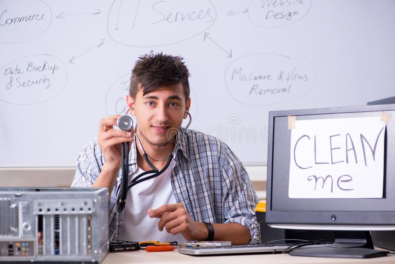 The young it specialist in front of the whiteboard stock photo