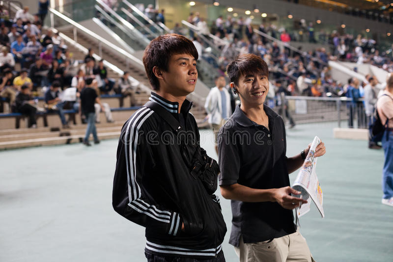 Young spectators bet on the winner royalty free stock photography