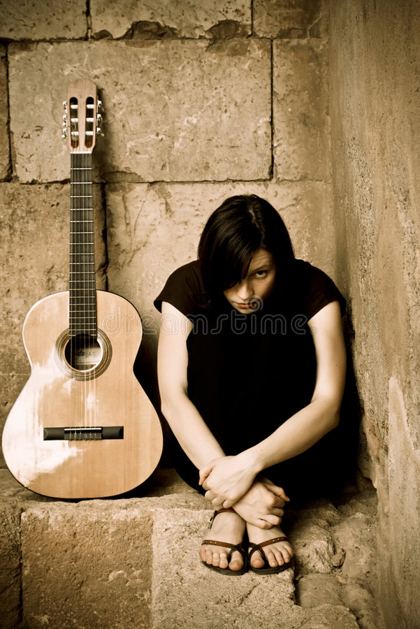 Young spooky guitarist royalty free stock photography