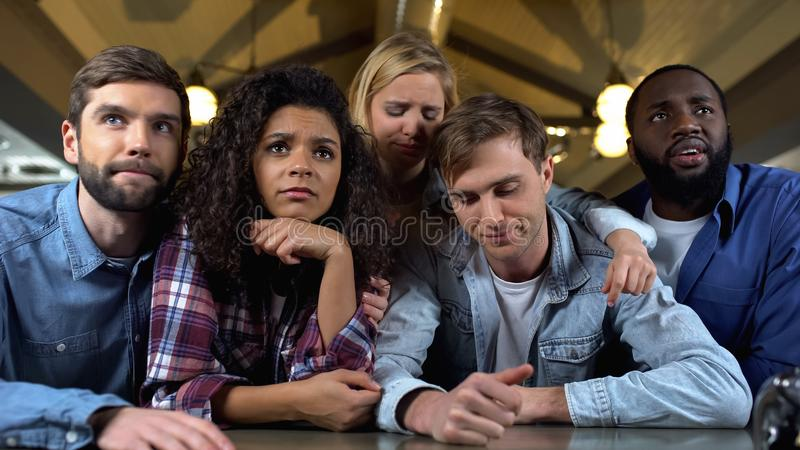 Young sport fans looking upset during national competition, championship online royalty free stock photo