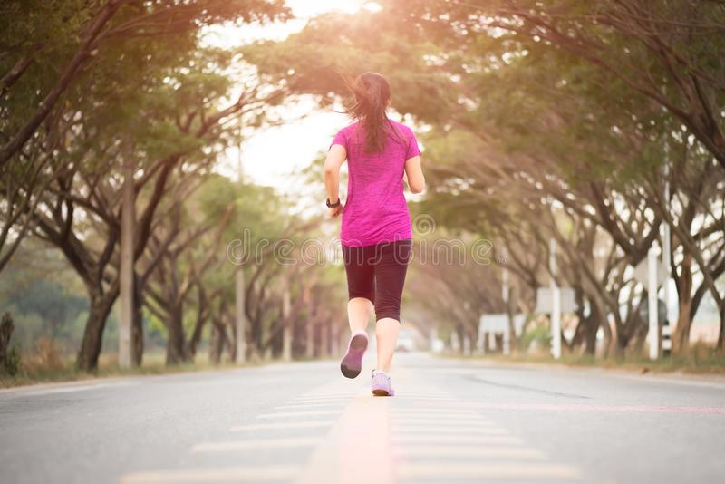 Young sport girl runner athlete running at road. Sport  and exercise concept royalty free stock photography