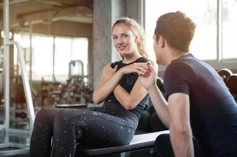 young sport woman exercise doing sit ups on the bench in fitness gym healthy .Muscular girl in sportswear training abs with royalty free stock photo