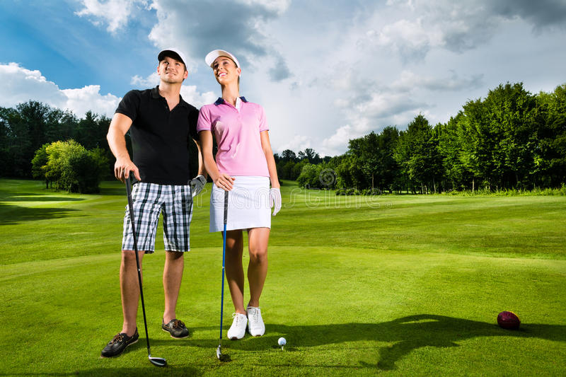 Download Young Sportive Couple Playing Golf On A Course Stock Photo - Image: 26869174