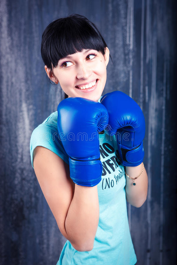 The young sports girl with dark hair stock images