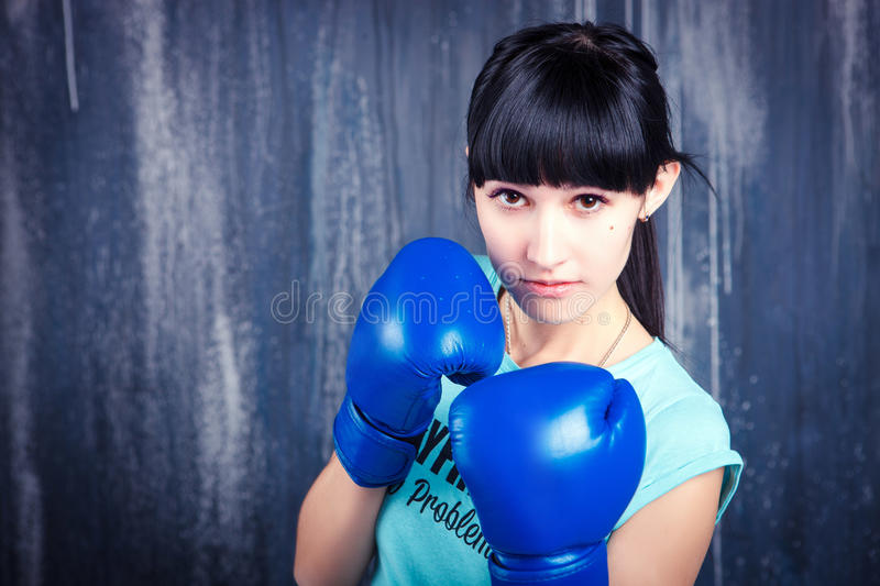 The young sports girl with dark hair stock photography