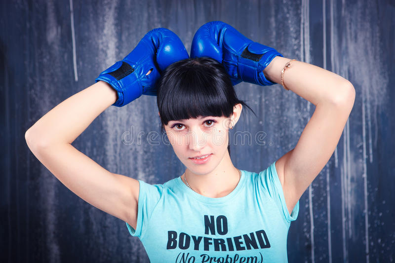 The young sports girl with dark hair stock photos