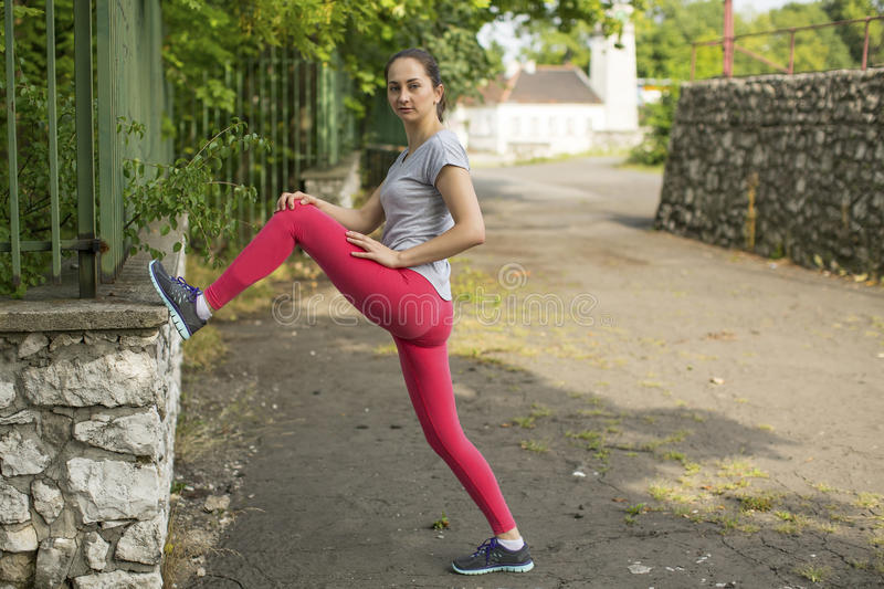 Young sports girl during workout in the Park. Fitness. Young sports girl during workout in the Park royalty free stock photos