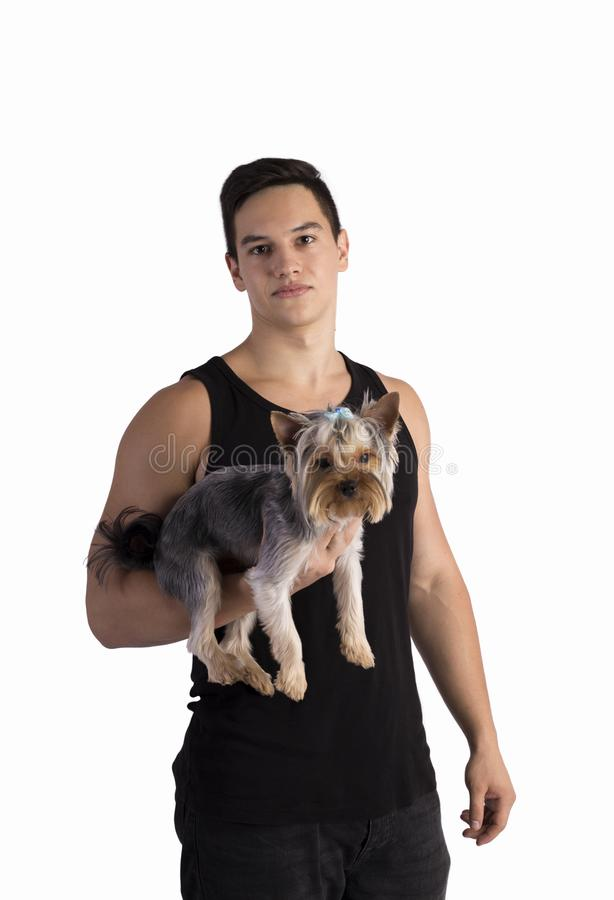 Young sporty guy with a cute little dog stock photo