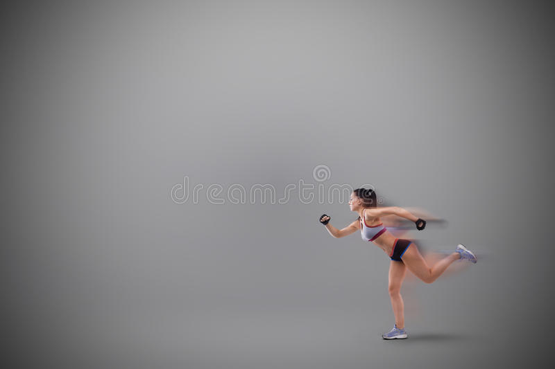 Young sports-looking nice lady with dark hair royalty free stock image