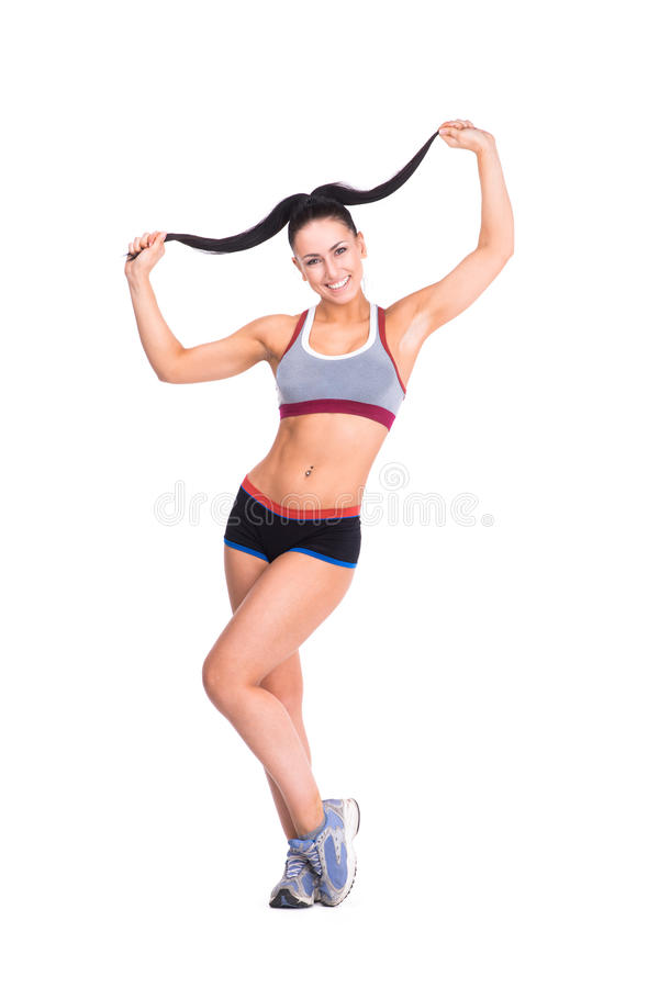 Young sports-looking nice lady with dark hair royalty free stock photos