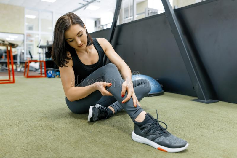 Young sports woman resting on the floor after exercises in gym. Fitness, sport, training, people, healthy lifestyle concept stock photos