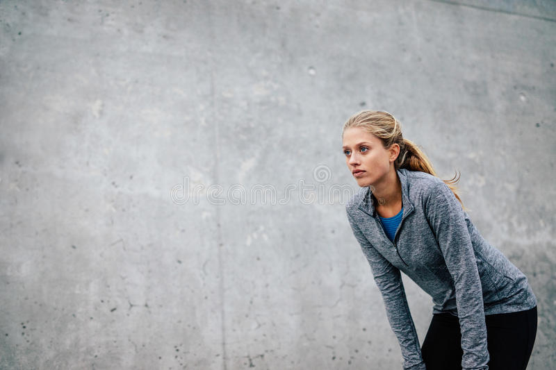 Young sports woman taking break after a run stock photography