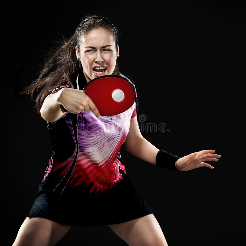 Young sports woman tennis-player in play on black royalty free stock images