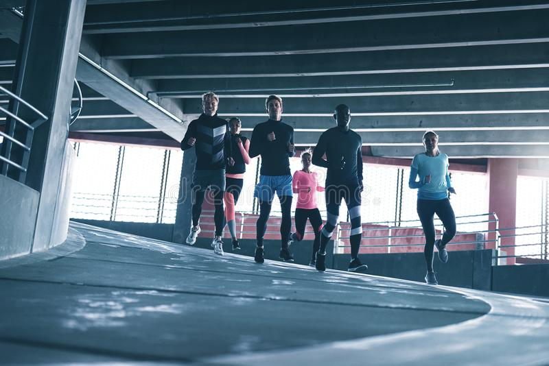Young runners in sportswear training royalty free stock image