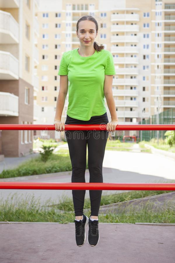 Young sportswoman stretching and preparing to run. Portrait stock photos