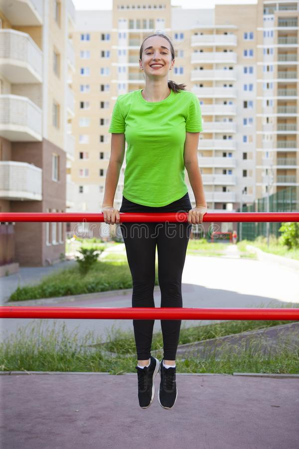 Young sportswoman stretching and preparing to run. Portrait stock photo