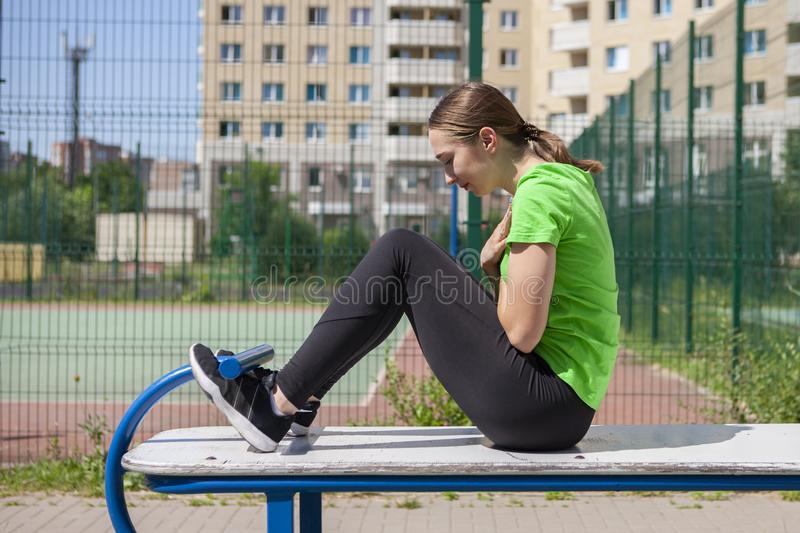 Young sportswoman stretching and preparing to run. Portrait stock image