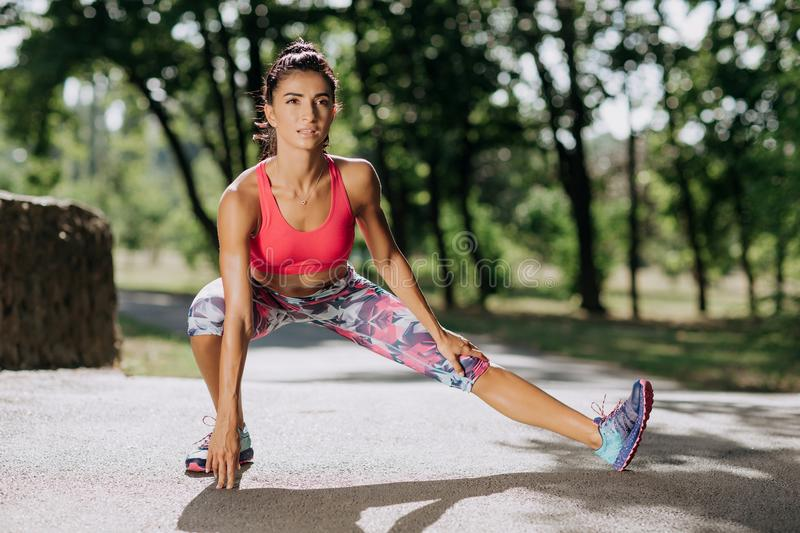 Young sportswoman stretching and preparing to run. Sport Lifestyle. stock photography