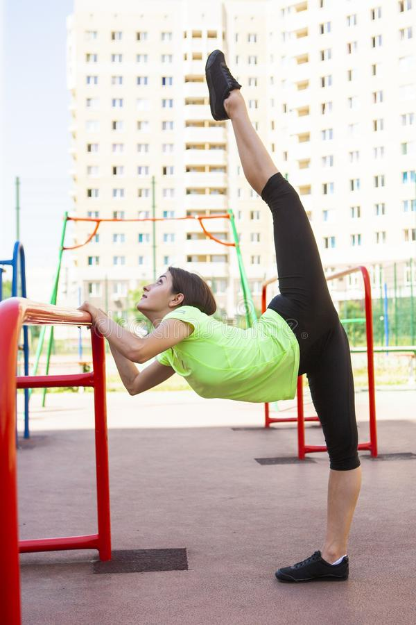 Young sportswoman stretching and preparing to run. Portrait royalty free stock images