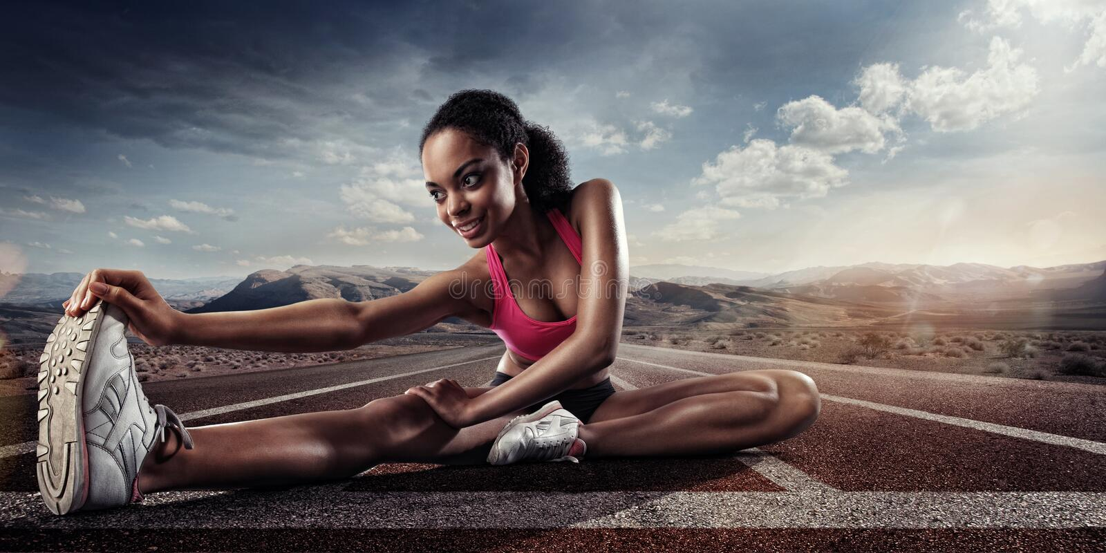 Young sportswoman stretching royalty free stock photos