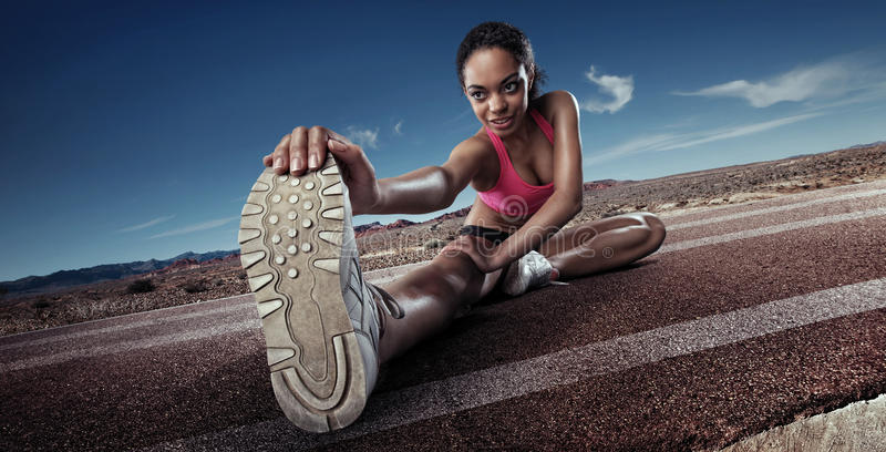Young sportswoman stretching royalty free stock image
