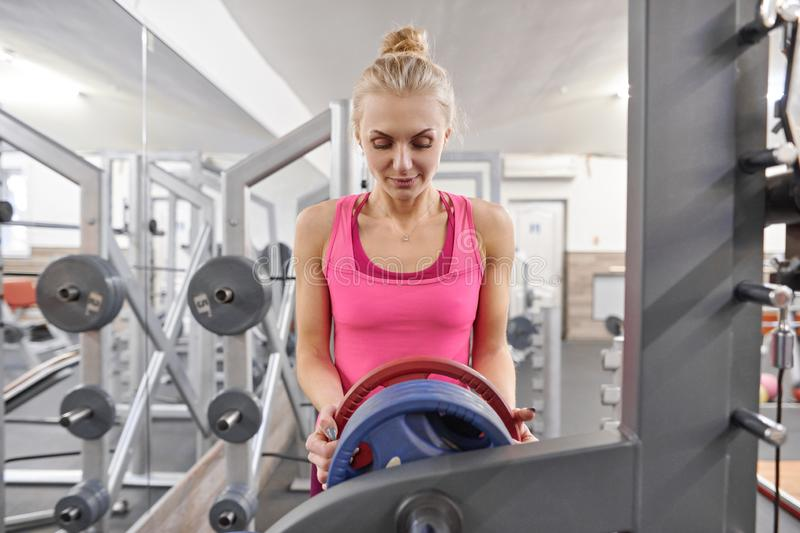 Young sporty blond woman in the gym. People fitness sport healthy lifestyle concept royalty free stock images