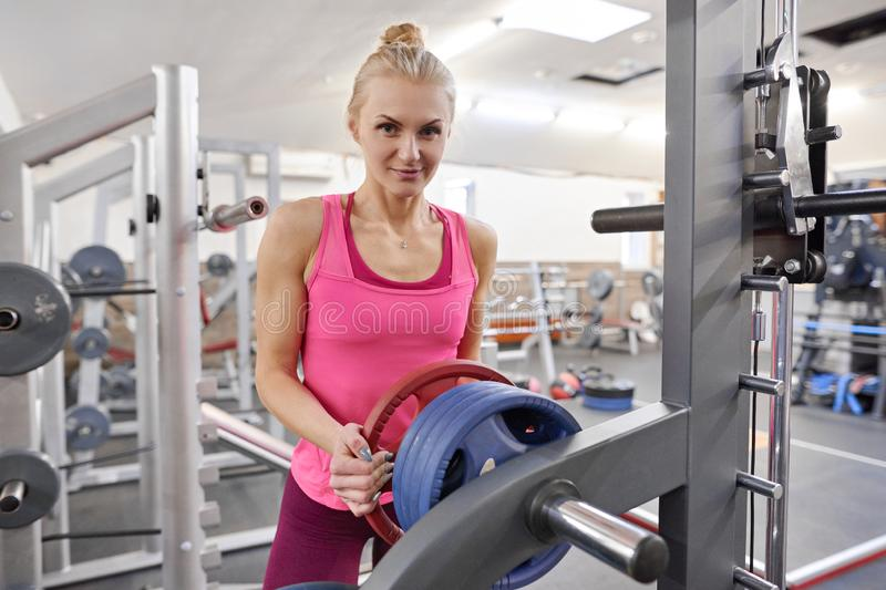 Young sporty blond woman in the gym. People fitness sport healthy lifestyle concept stock image