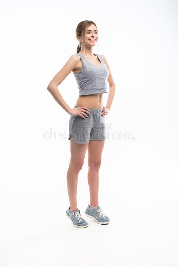 Young sporty Caucasian female model isolated on white background in full body. Fitness woman. Young sporty Caucasian female model isolated on white background in stock image