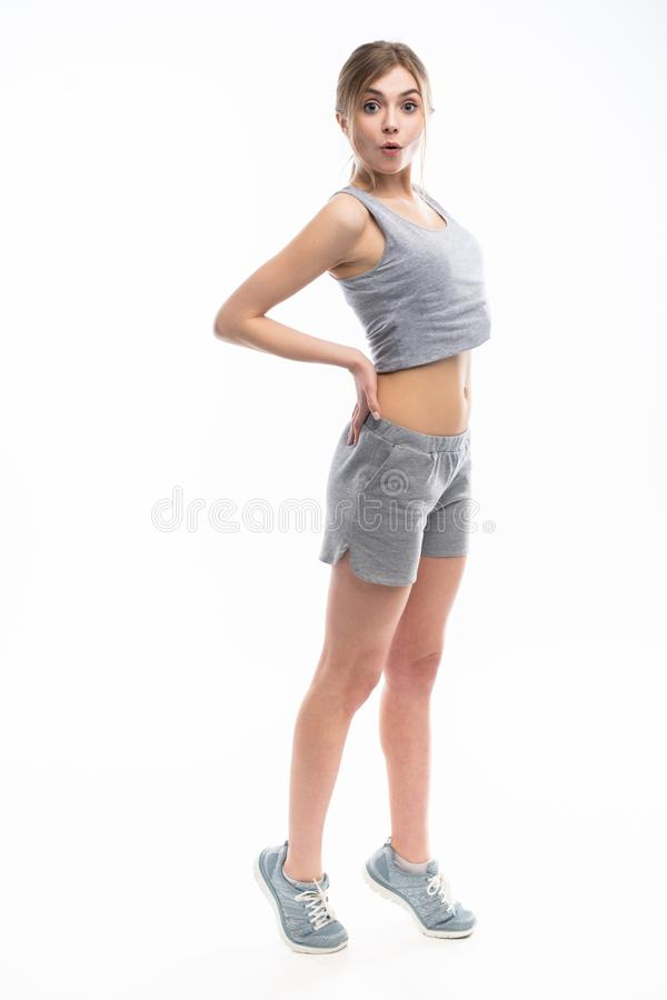Young sporty Caucasian female model isolated on white background in full body. Fitness woman. Young sporty Caucasian female model isolated on white background in stock photos