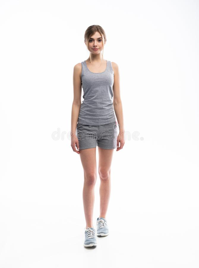 Young sporty Caucasian female model isolated on white background in full body. Fitness woman. Young sporty Caucasian female model isolated on white background in stock images