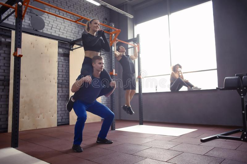 Young sporty couple working out together at gym royalty free stock images