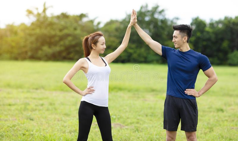 Sporty couple working out together outdoors. Young sporty couple working out together outdoors royalty free stock photography