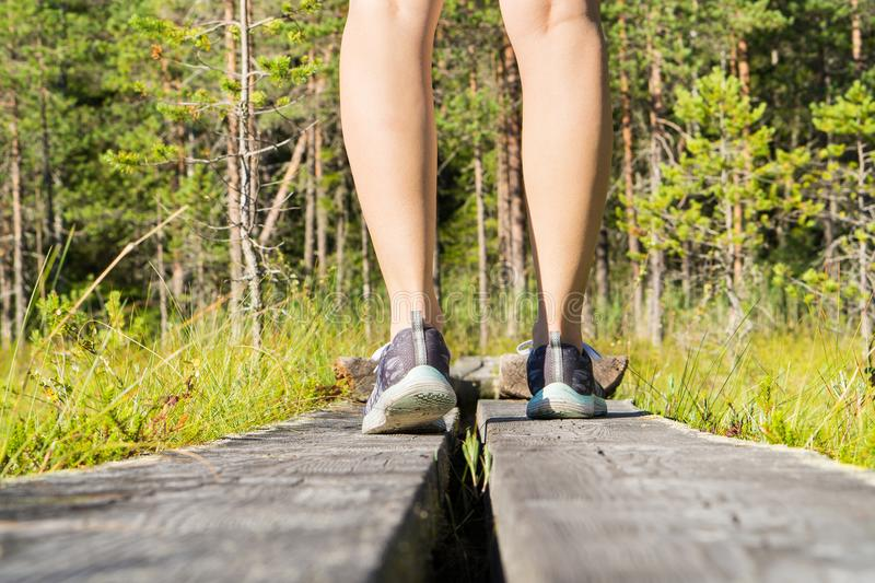 Young sporty fitness woman standing on wooden duckboard. royalty free stock photography