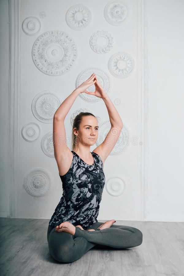 Young slender girl athlete performs fitness exercises and yoga stock photos