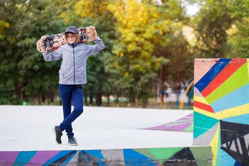 Young sporty girl riding on longboard in park stock photos