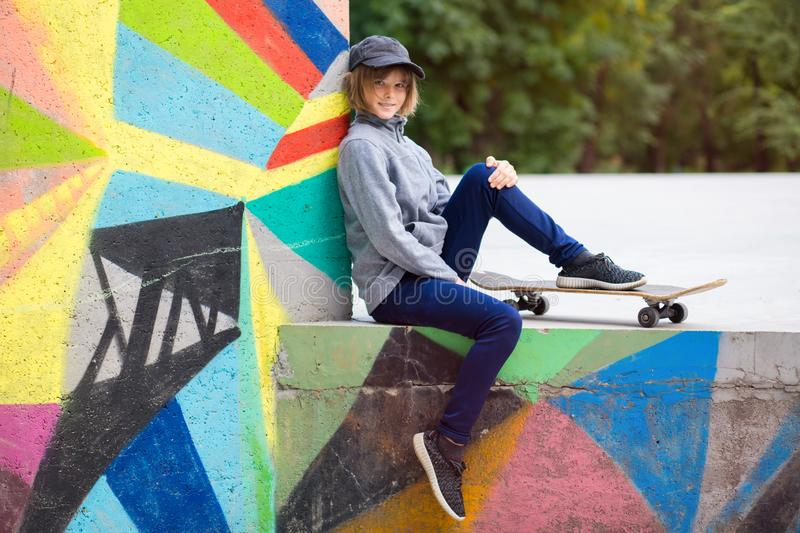 Young sporty girl riding on longboard in park stock photography