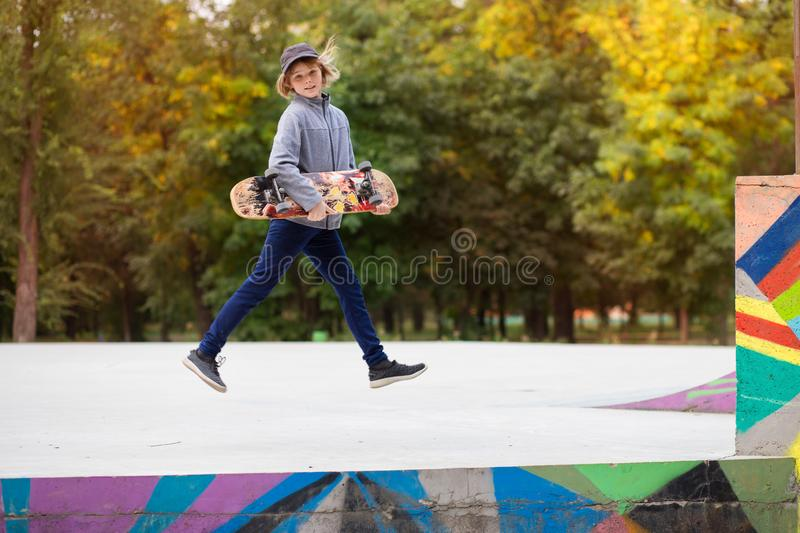 Young sporty girl riding on longboard in park royalty free stock photos