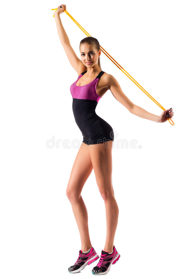 Young sporty girl with skipping rope. Isolated royalty free stock image
