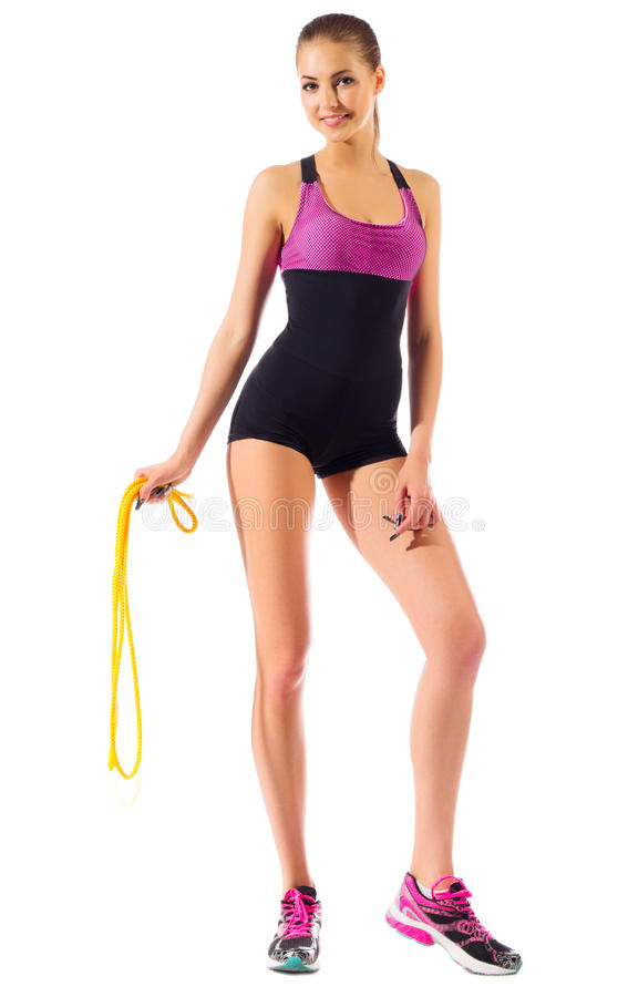 Young sporty girl with skipping rope. Isolated stock photo