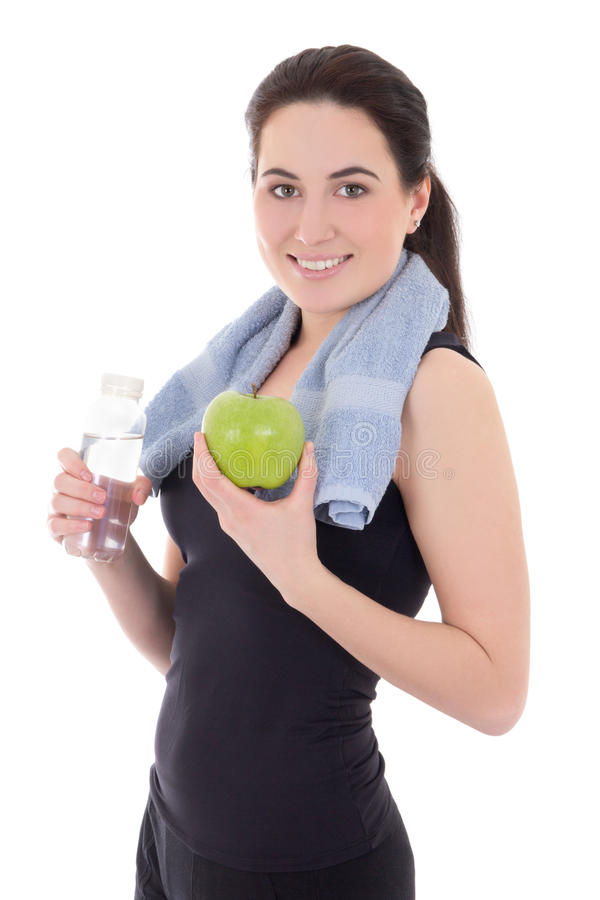 young sporty woman with bottle of mineral water and apple isolated on white royalty free stock photography