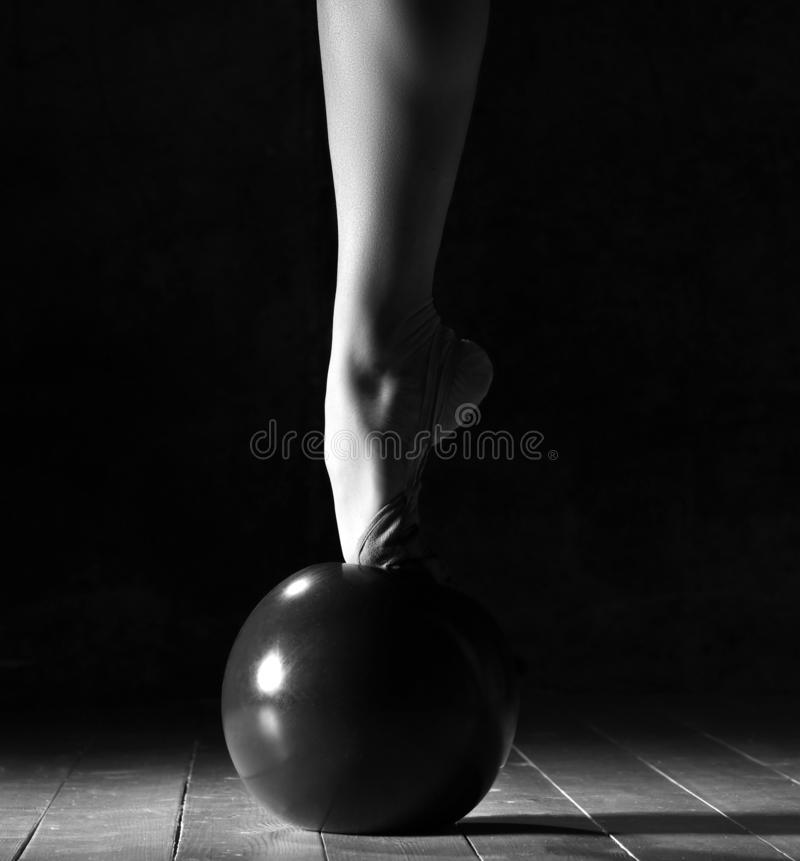 Young sporty woman doing gymnastics stretching fitness exercises workout with ball in sport gym royalty free stock photo