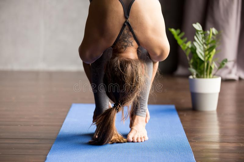 Young sporty woman doing head to knees exercise, close up stock images