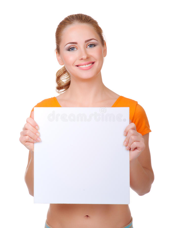 Young sporty woman hold blank billboard stock image