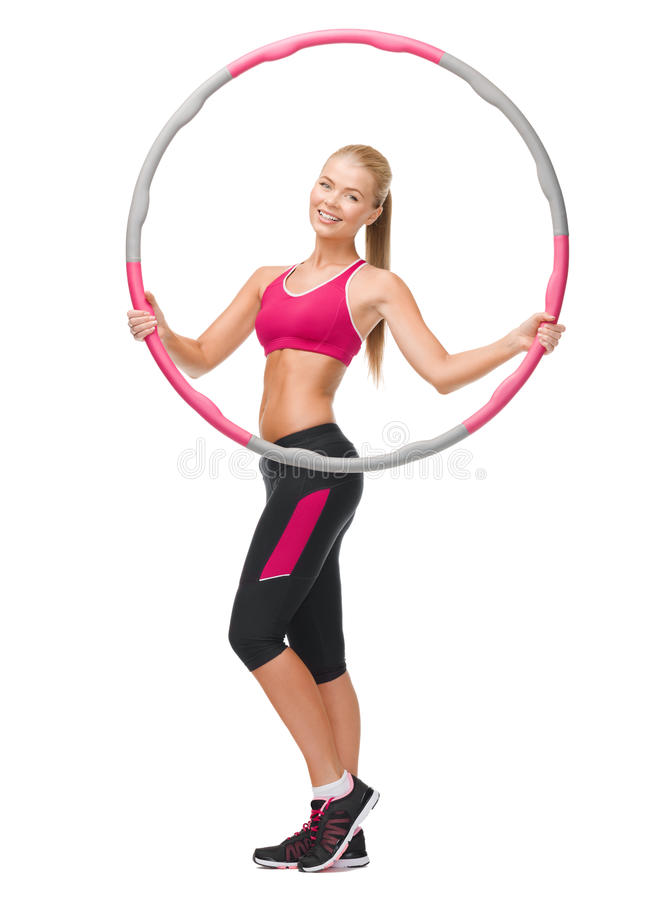 Young sporty woman with hula hoop royalty free stock images